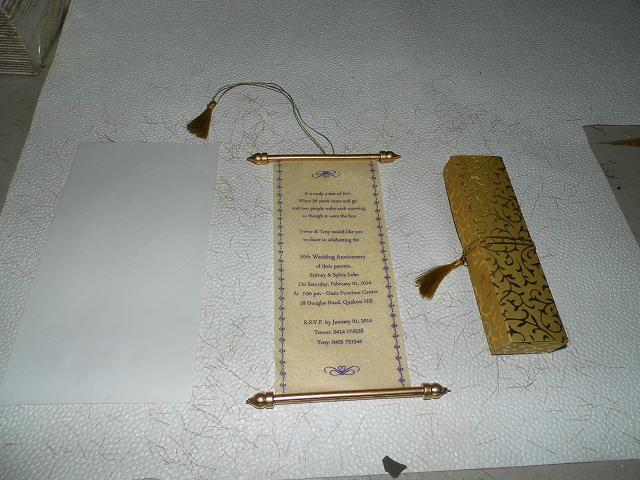 behind the scenes at conifer custom made scroll wedding invites